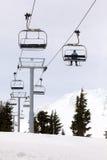 Skier Riding Ski Lifts Up Mount Hood. Skier Riding Ski Lifts up the slope of Mount Hood Oregon during Winter Skiing Season Stock Photos