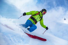 Skier riding the snow wave Stock Photography