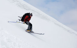 Skier running down. The mountain slope Royalty Free Stock Image