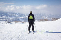 Skier Sets off Down a Piste in Niseko, Japan Royalty Free Stock Images