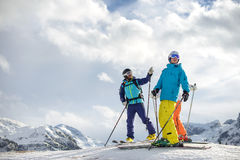 Skier showing friends the mountain tops stock photos
