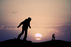 Skier silhouette at sunset Royalty Free Stock Photography