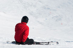 Skier sitting on ski slope Royalty Free Stock Photo