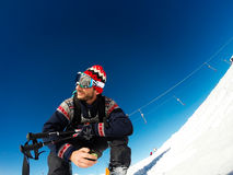 Free Skier Sitting Waiting To Start Skiing Stock Photography - 45140062