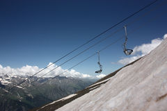 Skier on the ski lift Stock Images