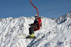 Skier on ski lift Stock Photos