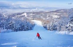 Skier on ski slope Royalty Free Stock Images