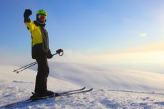 Skier on ski slope. With mountains in background Royalty Free Stock Photography