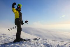 Skier on ski slope. With mountains in background royalty free stock photos