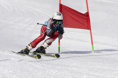 Skier skiing down mountain slope during competition alpine skiing giant slalom stock photography