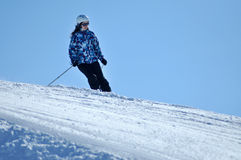 Skier skiing down on the piste Royalty Free Stock Photo
