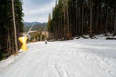 Skier is skiing down the slope in the woods. In winter Stock Photography
