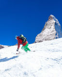 Skier skiing downhill in high mountains Royalty Free Stock Photos