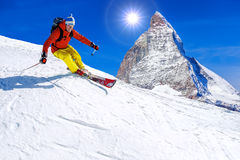 Skier skiing downhill in high mountains, Matterhorn, Switzerland Royalty Free Stock Images