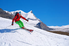 Skier skiing downhill in high mountains, Matterhorn, Switzerland Stock Photography