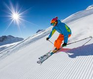 Skier skiing downhill in high mountains royalty free stock photography