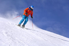 Skier skiing downhill Stock Photos