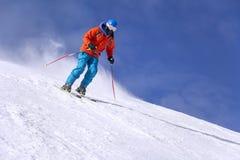 Skier skiing downhill Stock Photos