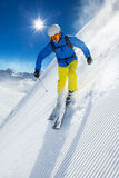 Skier skiing downhill in high mountains Stock Photography