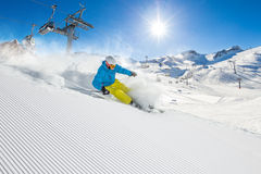 Skier skiing downhill in high mountains Stock Image