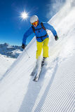 Skier skiing downhill in high mountains Royalty Free Stock Images