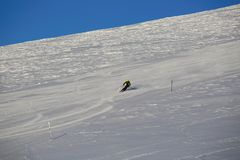 Skier skiing downhill in mountains Royalty Free Stock Photos
