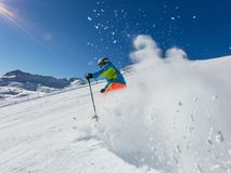 Skier skiing downhill in high mountains Royalty Free Stock Photo