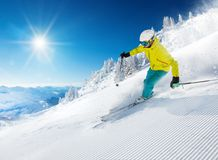Skier skiing downhill in high mountains Stock Photos