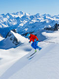 Skier skiing downhill Valle Blanche in french Alps in fresh powd. Er snow. Snow mountain range Mont Blanc with Grand Jorasses in background Stock Images