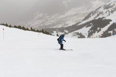 Skier skiing on fresh powder snow. winter season. Sports Royalty Free Stock Photos