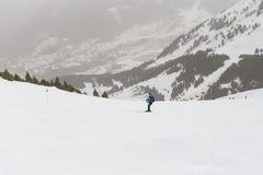 Skier skiing on fresh powder snow. winter season. Sports Royalty Free Stock Image