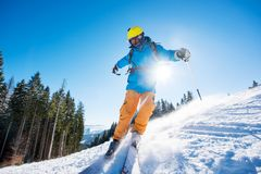Skier skiing in the mountains. Shot of a freerider skier skiing in the mountains on fresh powder snow copyspace recreation sports winter resort equipment gear Stock Photo