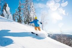 Skier skiing in the mountains Royalty Free Stock Image