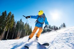 Skier skiing in the mountains. Shot of a professional skier skiing in the mountains on fresh powder snow at winter resort equipment gear concept copyspace royalty free stock photo