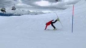 Skier skiing on ski on springboard on snowy slope and falling slow motion
