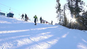 Skier skiing slope on sunny winter day stock video footage