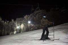 Skier skiing in snowy alps Stock Photo