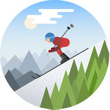 Skier sliding from the snowy hill Royalty Free Stock Images