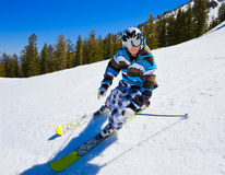 Skier on the Slop. Skier Riding down a Snowy Ski Slop Royalty Free Stock Photography