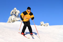 Skier on a slope Stock Images