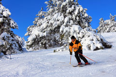 Skier on a slope. At a sharp turn Stock Photo