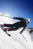 Skier on a slope. In switzerland royalty free stock image