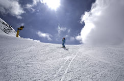 Skier on a slope. Skier on the slope of Austrian Alps, Solden, Austria Stock Photo