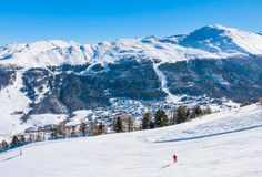 Skier on the slope of  Ski resort Livigno Stock Photo