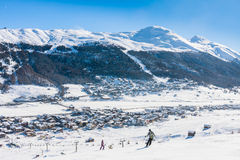 Skier on the slope of  Ski resort Livigno Royalty Free Stock Photos