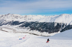 Skier on the slope of  Ski resort Livigno Royalty Free Stock Images