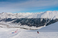 Skier on the slope of  Ski resort Livigno Royalty Free Stock Photo