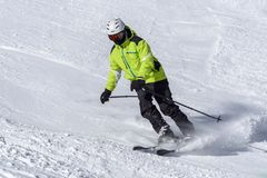Skier on the slope. Winter sport activity Royalty Free Stock Photos
