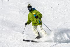 Skier on the slope. Winter sport activity Stock Photo