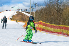 Skier on the slope in sunny day Royalty Free Stock Photos